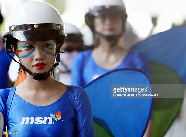 Models with painted faces wearing butterflylike costumes stand during a promotion for Microsoft local MSN portal in Bangkok 30 June 2004 Microsoft...