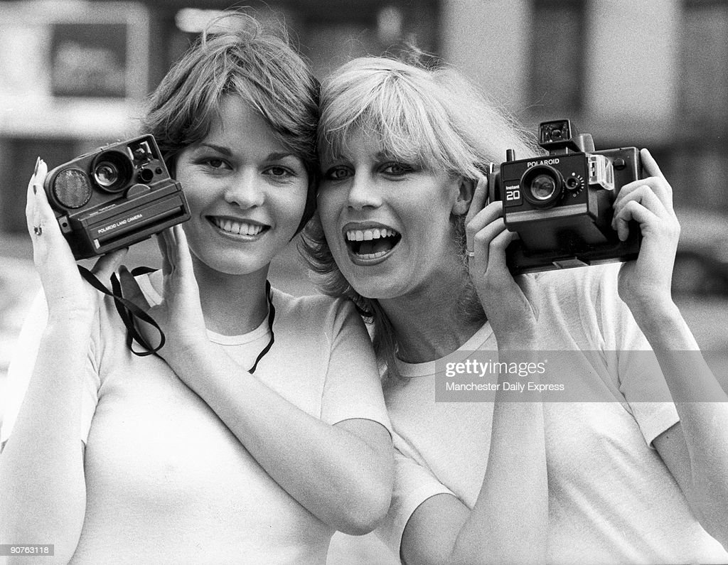 Models with Polaroid cameras, April 1979.