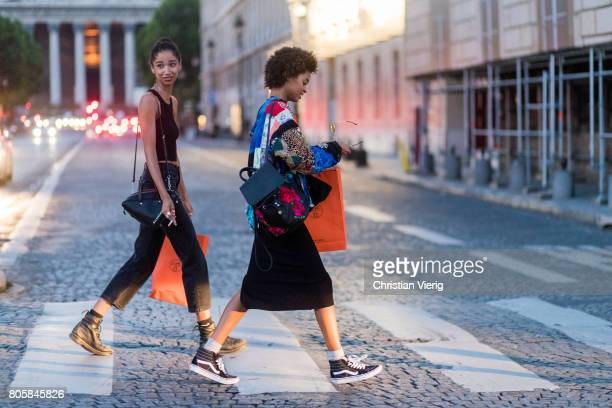 Models with shopping bags outside Miu Miu Cruise Collection during Paris Fashion Week Haute Couture Fall/Winter 20172018 Day One on July 2 2017 in...