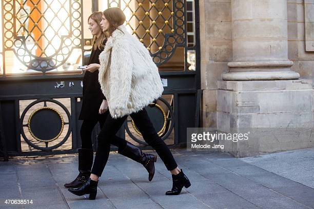 Models Yulia Musieichuck and Ella Zadavysvichka and exit the Ann Demeulemeester show at Couvent des Cordeliers on Day 3 of Paris Fashion Week FW15 on...