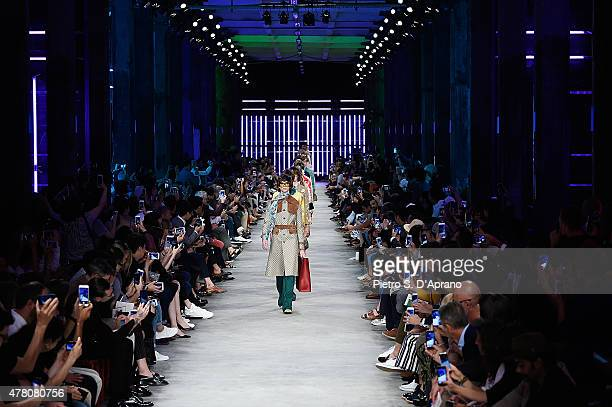 Modelsl walk the runway during the GUCCI fashion show as part of Milan Men's Fashion Week Spring/Summer 2016 on June 22 2015 in Milan Italy
