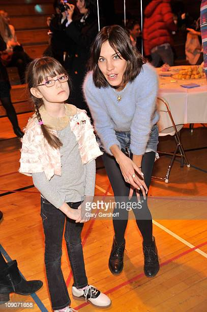 Model/television personality Alexa Chung and guest attend the Rachel Antonoff Fall 2011 presentation during Mercedes-Benz Fashion Week at F.H....