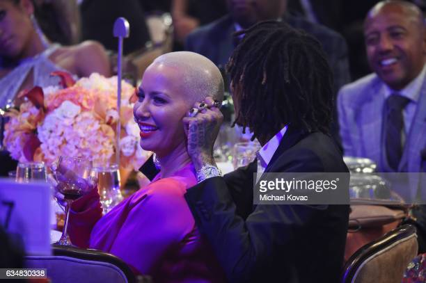 Model/TV personality Amber Rose and recording artist Wiz Khalifa attend PreGRAMMY Gala and Salute to Industry Icons Honoring Debra Lee on February 11...