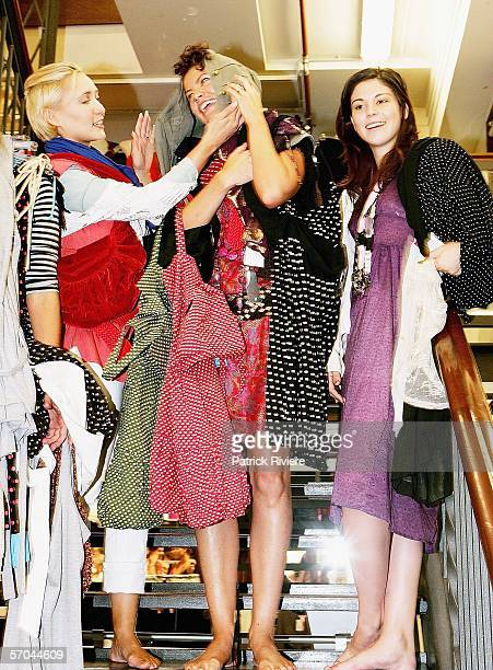 Model/TV personality Bessie Bardot singer Tiffani Wood and actress Kate Bell are laden down with clothes after taking part in the Supre Celebrity...