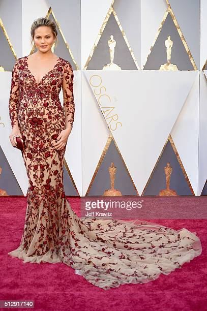 Model/TV personality Chrissy Teigen attends the 88th Annual Academy Awards at Hollywood Highland Center on February 28 2016 in Hollywood California