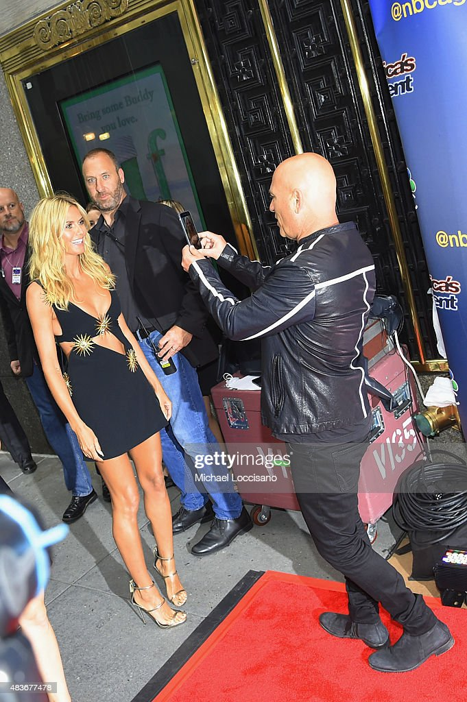 Model/TV personality Heidi Klum and comedian/TV personality Howie Mandel take a picture before the 'America's Got Talent' season 10 taping at Radio City Music Hall on August 11, 2015 in New York City.