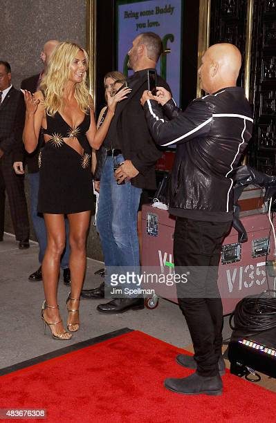 "Model/TV personality Heidi Klum and comedian/TV personality Howie Mandel attend the ""America's Got Talent"" season 10 pre-show red carpet at Radio..."