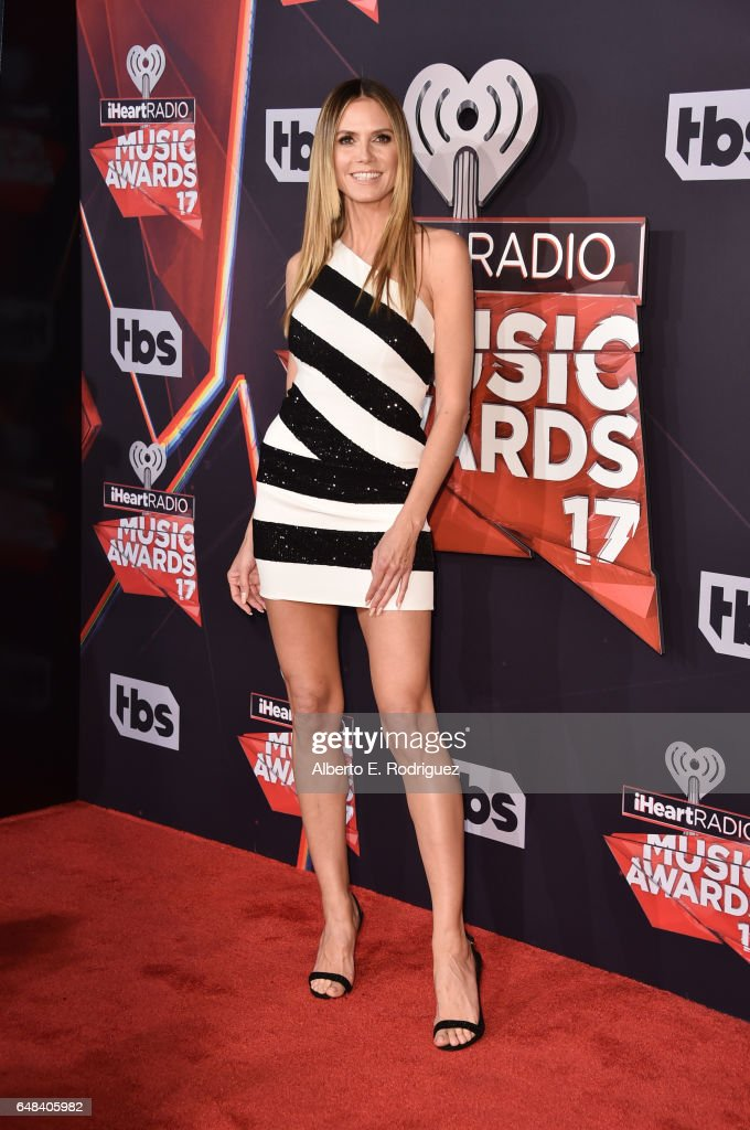 Model-TV personality Heidi Klum attends the 2017 iHeartRadio Music Awards which broadcast live on Turner's TBS, TNT, and truTV at The Forum on March 5, 2017 in Inglewood, California.