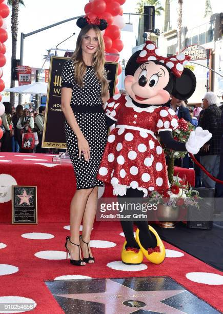 Model/TV personality Heidi Klum attends the ceremony honoring Disney's Minnie Mouse celebrating her 90th Anniversary with a star on the Hollywood...