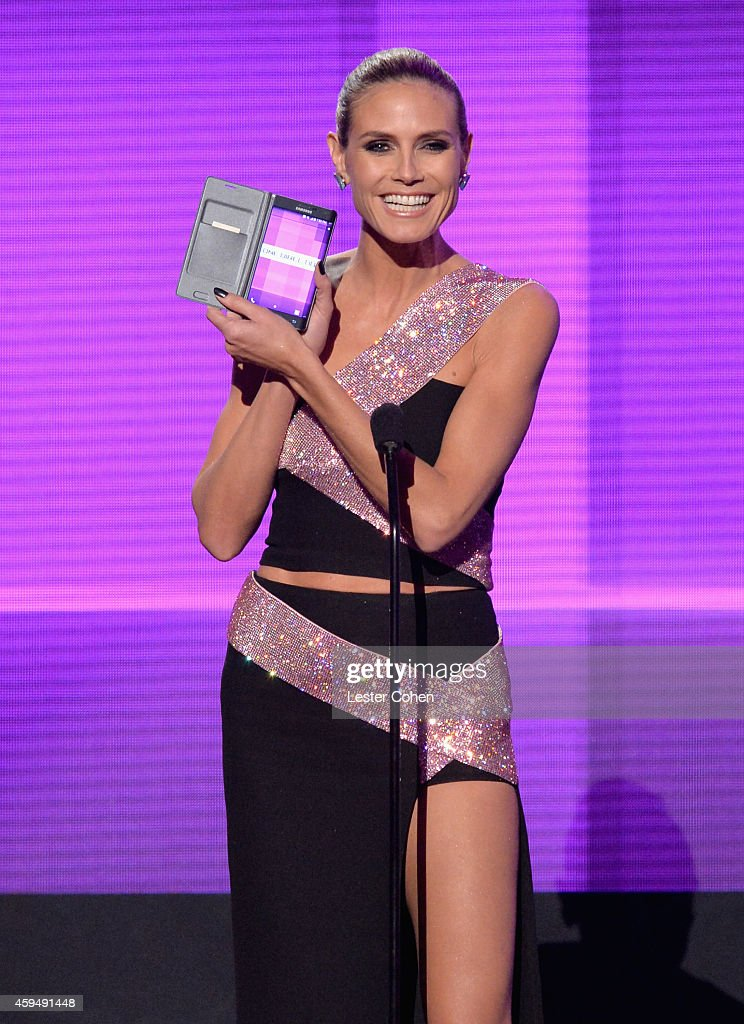 Model/TV personality Heidi Klum speaks onstage at the 2014 American Music Awards at Nokia Theatre L.A. Live on November 23, 2014 in Los Angeles, California.