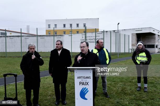 Modem centrist party MP Vincent Bru speaks next to European Green MP and member of the 'Artisans de la paix' movement Jose Bove and rightwing party...