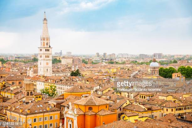 modena, cityscape and ghirlandina tower from a vantage point of view. emilia romagna, italy - モデナ ストックフォトと画像