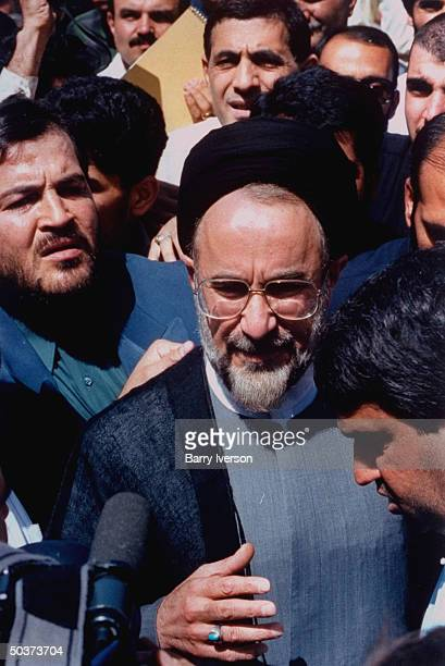 Moderate cleric presidential candidate Mohammed Khatami , surprise front-runner, greeting supporters outside polling station on election day.