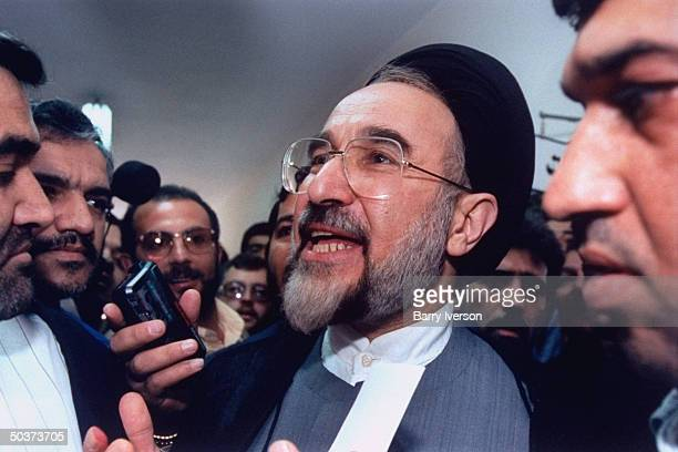 Moderate cleric presidential candidate Mohammed Khatami , surprise front-runner, speaking to reporters before voting at polling station on election...