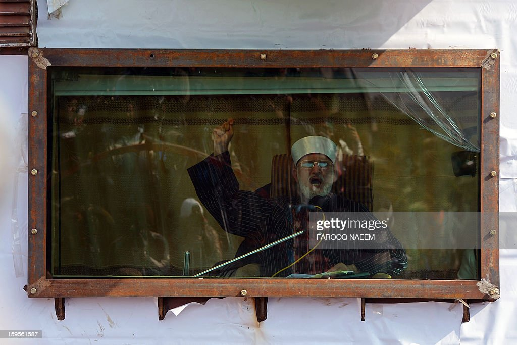 Moderate Pakistani preacher Tahir-ul Qadri addresses his audience behind bullet proof glass on the third day of a protest rally in Islamabad on January 16, 2013. Pakistani protesters rallied for a third day January 16 in the largest political demonstration seen for years in the capital, calling on the government to quit after the Supreme Court ordered the arrest of the prime minister. AFP PHOTO/Farooq NAEEM