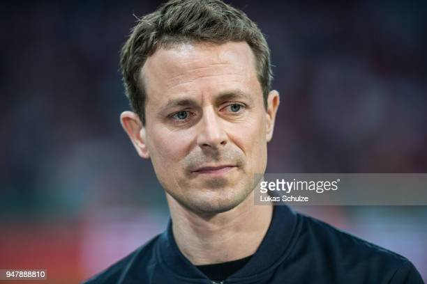 Moderator Alexander Bommes looks up prior to the DFB Cup semi final match between Bayer 04 Leverkusen and Bayern Muenchen at BayArena on April 17...
