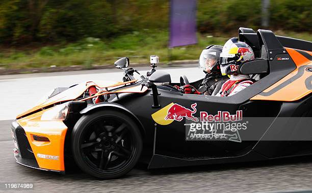 Moderator and comedian Guido Cantz and DTM driver Martin Tomczyk racing in a KTM XBow car during the Red Bull On Track event at the Driving Safety...