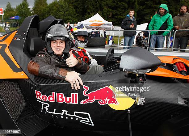 Moderator and comedian Guido Cantz and DTM driver Martin Tomczyk attend the Red Bull On Track event at the Driving Safety Center on July 23 2011 in...