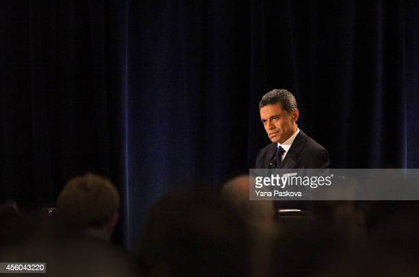 Moderator and journalist Fareed Zakaria listens as President of Iran Hassan Rouhani speaks at the New York Hilton Midtown on September 24 2014 in New...