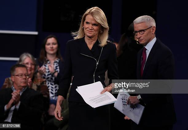 CNN moderator Anderson Cooper and ABC moderator Martha Raddatz appear on stage during the second presidential debate with democratic presidential...