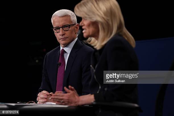CNN moderator Anderson Cooper looks on as ABC moderator Martha Raddatz speaks during the second presidential debate with democratic presidential...