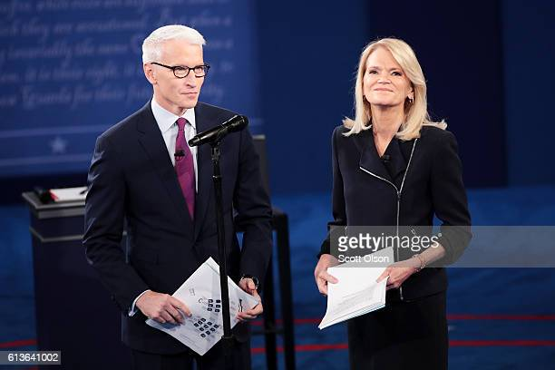 Moderator Anderson Cooper of CNN and moderator Martha Raddatz of ABC stand before the town hall debate at Washington University on October 9 2016 in...