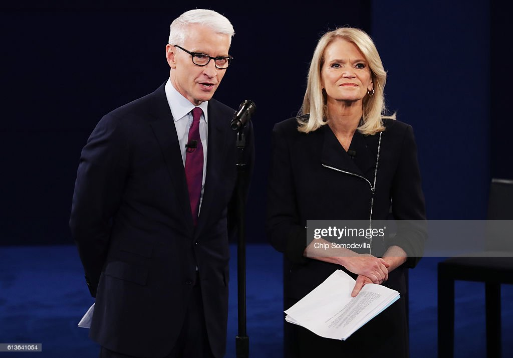 Moderator Anderson Cooper of CNN (L) and moderator Martha Raddatz of ABC speak before the town hall debate at Washington University on October 9, 2016 in St Louis, Missouri. This is the second of three presidential debates scheduled prior to the November 8th election.