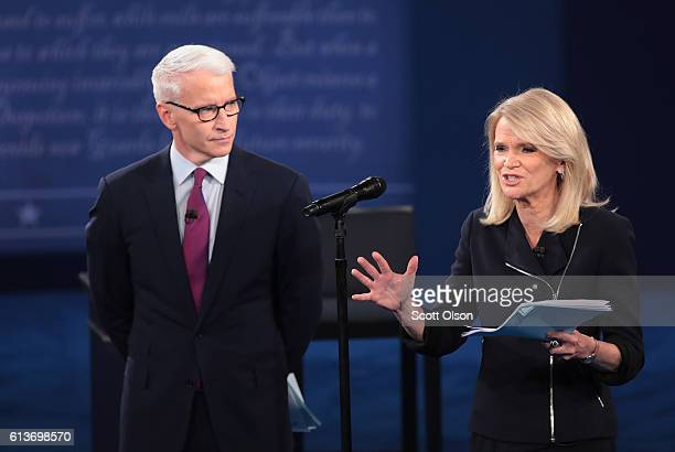 Moderator Anderson Cooper of CNN and moderator Martha Raddatz of ABC speak before the town hall debate at Washington University on October 9 2016 in...