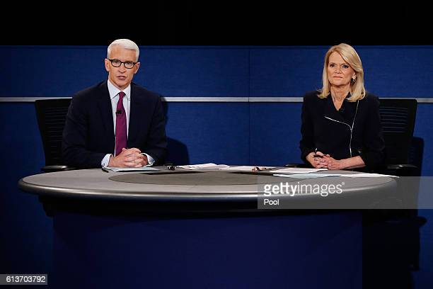 Moderator Anderson Cooper of CNN speaks as moderator Martha Raddatz of ABC looks on during the town hall debate at Washington University on October 9...