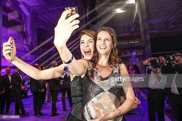 Moderator Annett Moeller and actress Katrin Wrobel make a selfie during the Duftstars 2016 After Show Party at Kraftwerk Mitte on May 12, 2016 in...