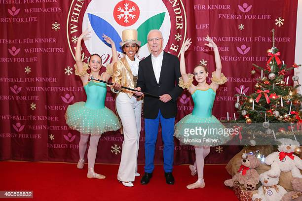 Moderator Arabella Kiesbauer and special guest Franz Beckenbauer pose with two children at the Energy For Life Christmas Ball For Children at Hofburg...