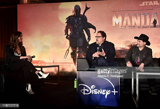 Moderator Ash Crossan executive producers/writers Jon Favreau and Dave Filoni of Lucasfilm's The Mandalorian at the Disney Global Press Day on...