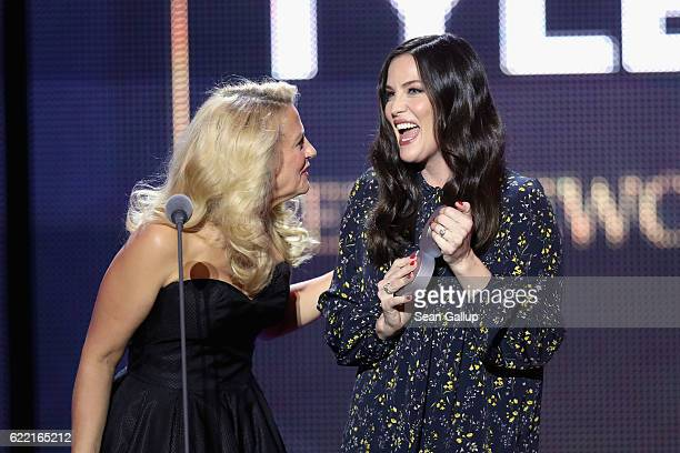 Moderator Barbara Schoeneberger and Liv Tyler are seen on stage at the GQ Men of the year Award 2016 show at Komische Oper on November 10 2016 in...