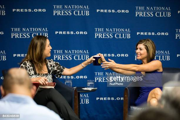Moderator Betsy Fischer Martin CoChair of the NPC Headliners Committee hands a NPC coffee mug as a gift to former CBS News Correspondent Sharyl...