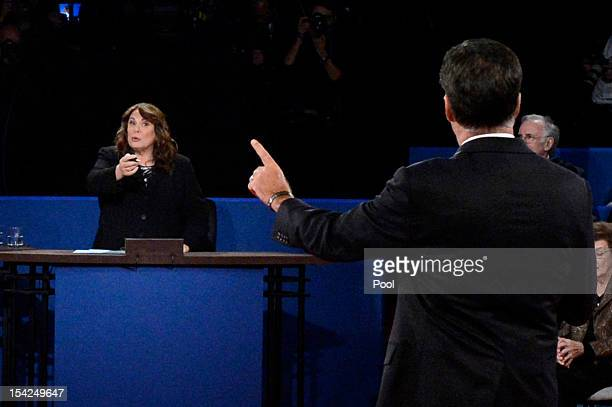 Moderator Candy Crowley and Republican presidential candidate Mitt Romney speak during a town hall style debate at Hofstra University October 16 2012...