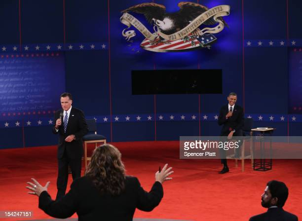 Moderator Candy Crowley of CNN tries to bring Republican presidential candidate Mitt Romney and US President Barack Obama back on topic during a town...