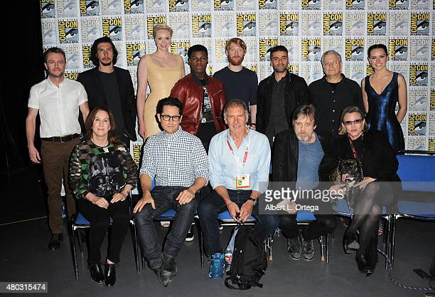 Moderator Chris Hardwick actors Adam Driver Gwendoline Christie John Boyega Domhnall Gleeson and Oscar Isaac screenwriter Lawrence Kasdan and actress...