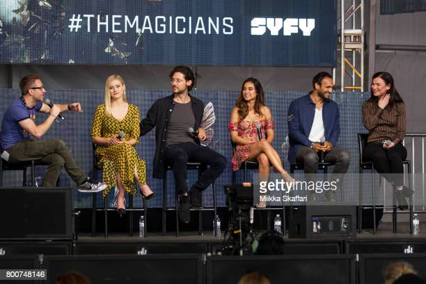 Moderator Chris Hardwick actors Olivia Taylor Dudley Hale Appleman Summer Bishil Arjun Gupta and writer Sera Gamble talk at The Magicians panel at...