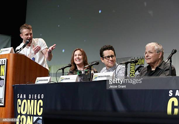 Moderator Chris Hardwick producer Kathleen Kennedy director JJ Abrams and screenwriter Lawrence Kasdan at the Hall H Panel for Star Wars The Force...