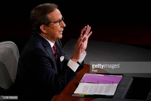 Moderator Chris Wallace of Fox News gestures toward President Donald Trump and former Vice President and Democratic presidential nominee Joe Biden at...