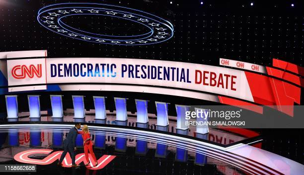 Moderator CNN anchor Don Lemon and moderator CNN chief political correspondent Dana Bash greet each other onstage ahead of the first round of the...