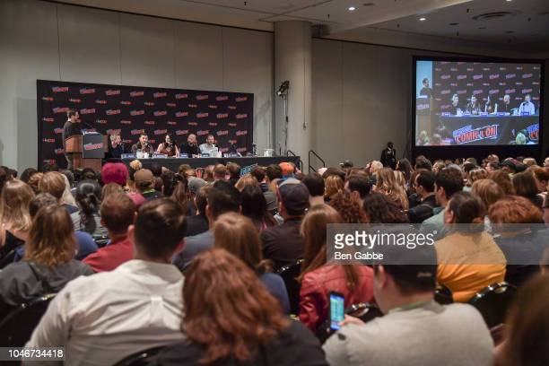 Moderator Damian Holbrook Aidan Gillen Michael Malarkey Laura Mennell Sean Jablonski and David O'Leary speak during HISTORYs Project Blue Book NYCC...