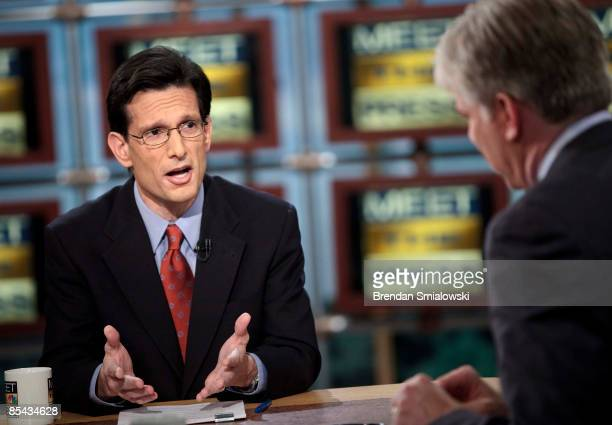 Moderator David Gregory listens while Rep Eric Cantor House Republican Whip speaks during a live taping of 'Meet the Press' at NBC studios March 15...
