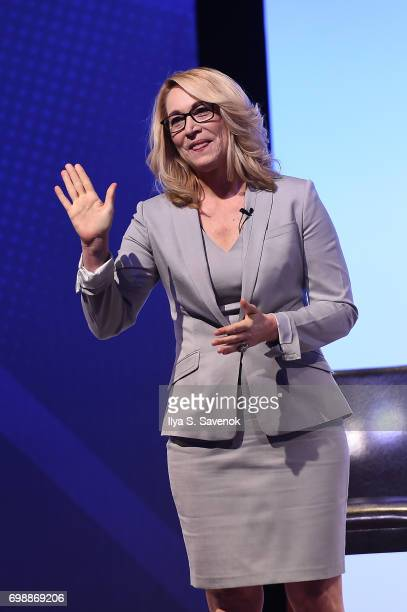 Moderator Doris Burke walks onstage during American Express Teamed Up with Shaquille O'Neal and Alonzo Mourning on June 20 2017 in New York City