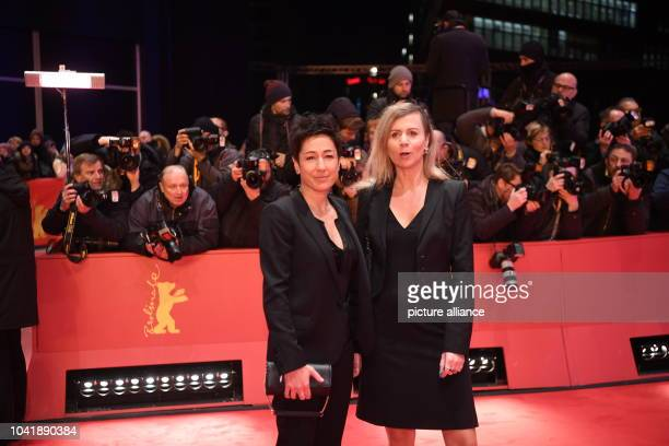 Moderator Dunja Hayali and Pamela Schobess arrive at the opening gala of the 67th Berlinale film festival for the premiere of the nominated film...
