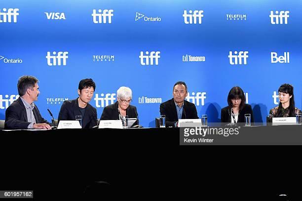 Moderator Eric Kohanik director Sangil Lee translator actor Ken Watanabe translator and actress Aoi Miyazaki speak onstage at the Rage press...