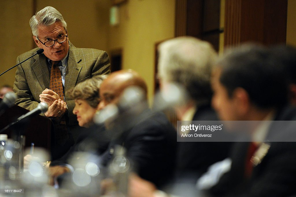 Moderator Floyd Ciruli asks a question to candidates during a mayoral forum at the Denver Athletic Club on Wednesday, March 2, 2011. AAron Ontiveroz, The Denver Post : News Photo