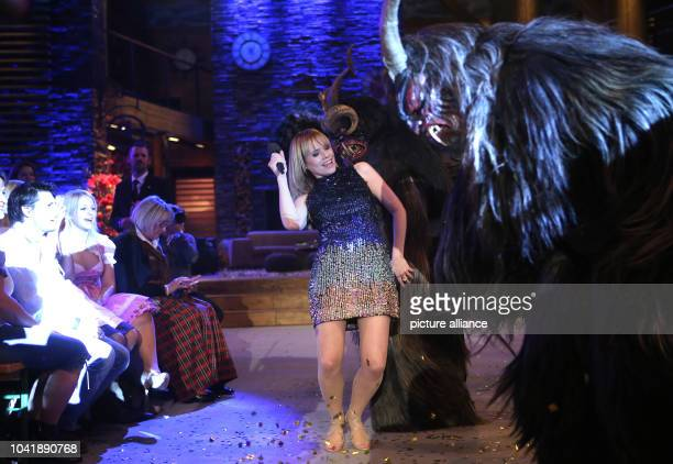 Moderator Francine Jordi and Perchten performers at a rehearsal for the broadcast of the 'Stadlshow' in Linz Austria 30 Decemeber 2015 The show will...