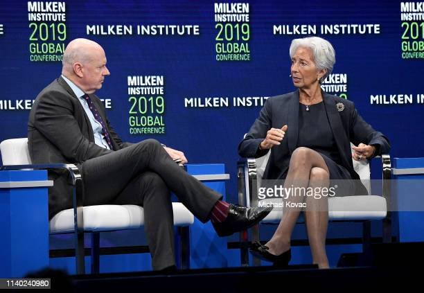 Moderator Gerard Baker EditoratLarge The Wall Street Journal and Christine Lagarde managing director of the International Monetary Fund participate...