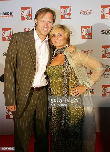 Moderator Gerhard Delling and his wife Isabelle attend the Sport Bild Award 2008 at the Elb Lounge August 25 2008 in Hamburg Germany